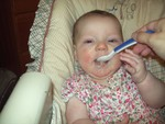 Highlight for Album: (almost) 1st cereal feeding